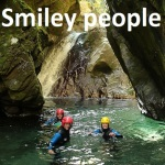 9 Smiley people Cross